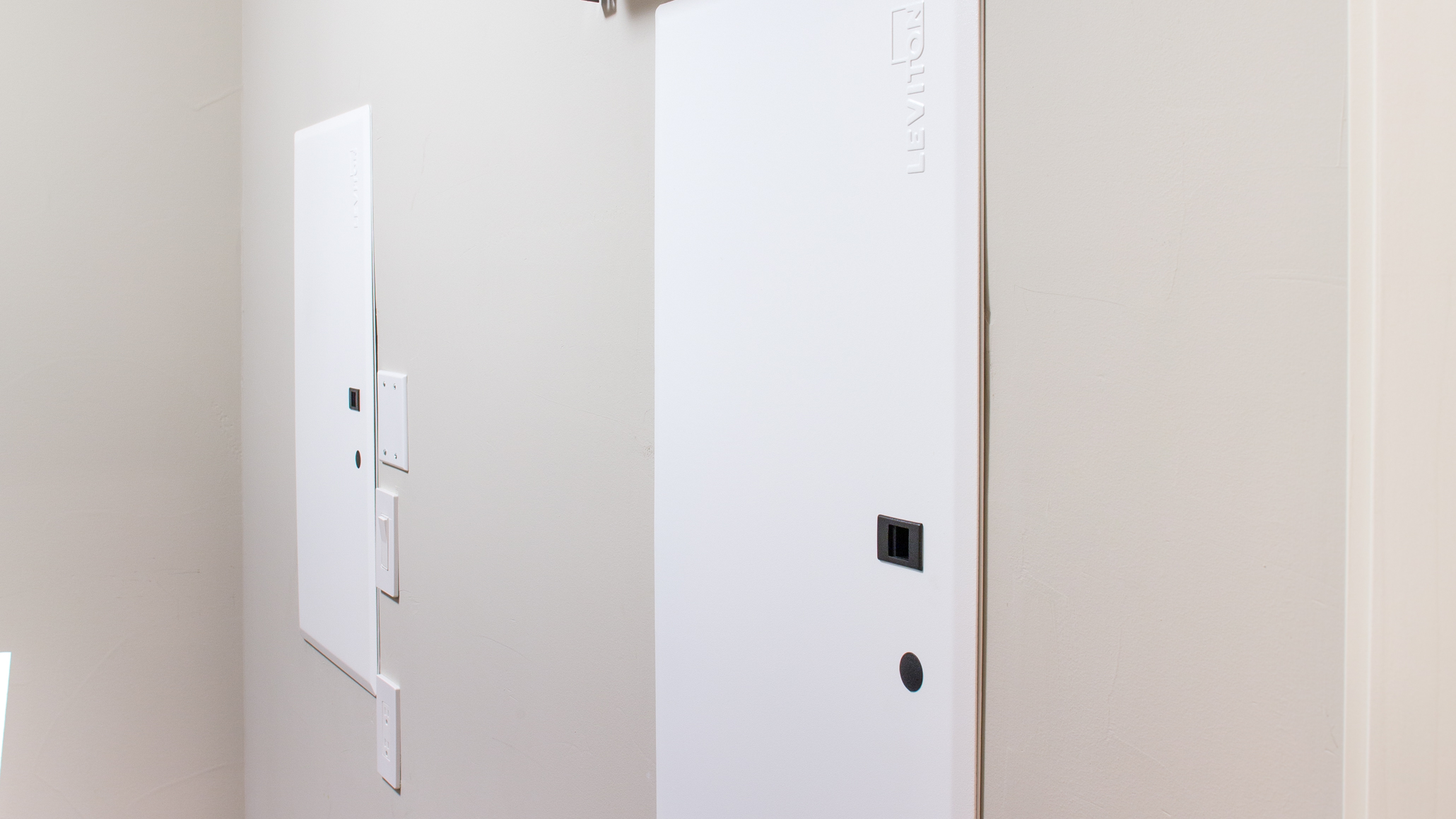 For maximum convenience, these Leviton 47605 structured media enclosures from are fitted with the company's hinged metal doors. Image: Digitized House Media.