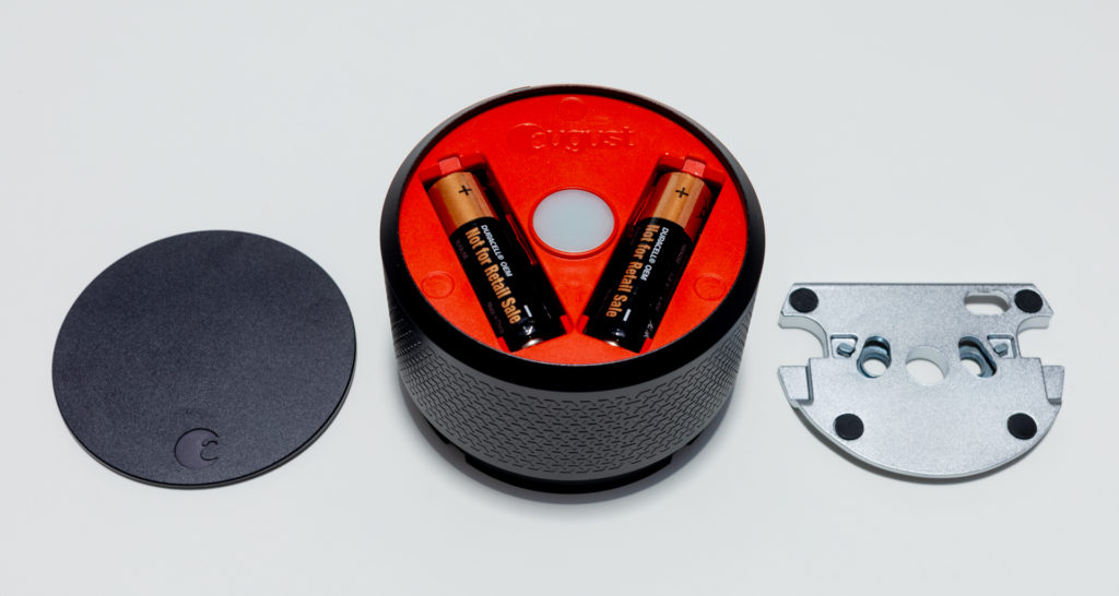 A set of four AA batteries power the August Smart Lock Pro and reside behind the magnetic faceplate. A cast metal mounting plate attaches to the door. Image: Digitized House.